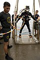 Defense.gov News Photo 100722-N-2831C-005 - U.S. Navy Petty Officer 2nd Class Matthew Wilson assigned to Mobile Diving and Salvage Unit 2 waits to be lowered over the side of the USNS Grasp.jpg