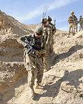 Defense.gov News Photo 111119-F-SA682-065(2) - U.S. Army soldiers with the Kandahar Provincial Reconstruction Team security force climb down from their positions during a site assessment of the.jpg