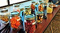 Dehydrated fruits and vegetables in labeled mason jars.jpg