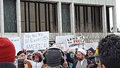 "Crowd of people in Dearborn Michigan. Signs are visible, including one reading ""We are all equal! America!"" and ""Land of the free? #NoBanNoWall"""