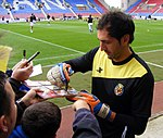 Diego Lopez autograph signing, Wigan Athletic v Villarreal CF, 7 August 2011.jpg