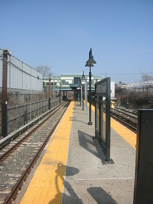 East 105th Street (BMT Canarsie Line) - Platform view; the station house at East 105th Street is in the background