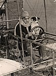 Edmond Poillot flying a Voisin biplane with a dog, Smithsonian National Air and Space Museum.jpg