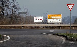 Lane - A left-turn merging lane in Germany, needing explanation by a crafted sign
