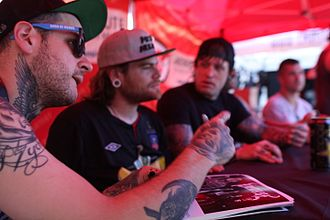 Emmure - Emmure at a signing table during 2013's Mayhem Festival.
