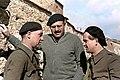 Ernest Hemingway with Soviet and German intellectuals Ilya Ehrenburg and Gustav Regler, possibly working on the propaganda film The Spanish Earth, Spain, 1937. (25888498228).jpg