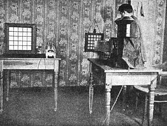 Mechanical television - Ernst Ruhmer demonstrating his experimental television system, which was capable of transmitting images of simple shapes over telephone lines, using a 25-element selenium cell receiver (1909)