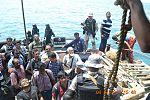 Evacuees look on after embarking INS Mumbai, during Operation Raahat.jpg