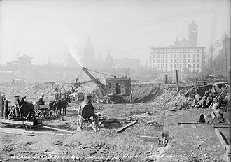 Union Station (Toronto) - Excavations for the third Union Station in 1915, with second Union Station in background.