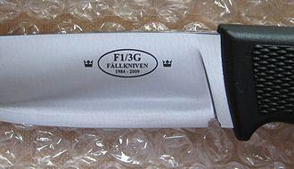 Fällkniven - Fallkniven F1, 25 year anniversary blade stamp.