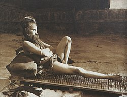 Fakir on bed of nails Benares India 1907.jpg