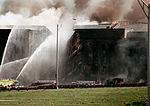 Firefighters struggle to contain the fire, after the September 11, 2001, terrorist attack on the Pentagon 010911-N-FX879-001.jpg