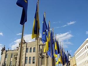 House with Chimaeras - Flags of Ukraine and the European Union in front of the building during an official event