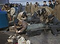 Fleet Air Arm personnel fusing bombs for Fairey Barracudas on the flight deck of HMS VICTORIOUS, before Operation 'Tungsten', the attack on the German battleship TIRPITZ in Alten Fjord, Norway, April 1944. TR1812.jpg