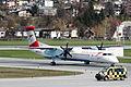 Flughafen Innsbruck im Frühling - Dash 8 wird abgeholt (6904178978).jpg