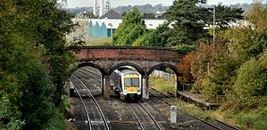 Knockmore railway station - Class 3000 train passing the remains of Knockmore station in 2010