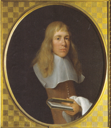 A man with long fair hair in 17th century dress