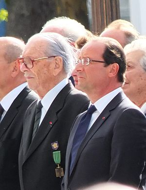 Fred Moore (soldier) - Fred Moore (left) next to former President François Hollande (right).