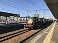 Freight train at Kashii Station.jpg