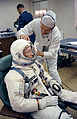 Gemini 4 White with suit technician.jpg