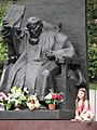 Girl with Sculpture of Pope John Paul II - Old Town - Przemysl - Poland (36204168112).jpg