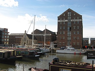 19th-century warehouses in Gloucester docks in the United Kingdom, originally used to store imported corn GlosDocks.jpg