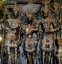 sculpture in temple column showing three figures