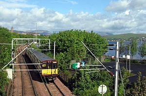 Inverclyde Line - A Class 314 train leaves Gourock pierhead to run along the south bank of the Firth of Clyde towards Glasgow