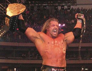 The Invasion (professional wrestling) - The WCW World Heavyweight Championship was later unified with the WWF Championship to form the WWF Undisputed Championship. Here, Triple H holds both belts at WrestleMania X8 on March 17, 2002