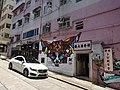 HK 上環 Sheung Wan 差館上街 Upper Station Street Hollywood Building outdoor sidewalk carpark white Mercede-Benz CLS head July 2015 DSC graffiti.JPG