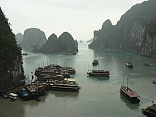 Ha Long Bay with boats.jpg