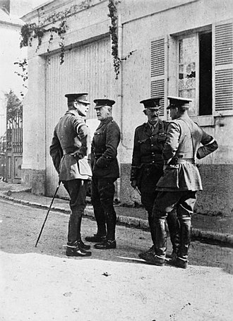 Douglas Haig, 1st Earl Haig - Haig with Major-General C. C. Monro (commanding 2nd Division), Brigadier-General J. E. Gough (Haig's Chief of Staff), and Major General Sir Edward Perceval (commander of 2nd Division's artillery) in a street in France, 1914.