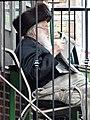 Hasidic Elder Reads on His Balcony - Borough Park - Hasidic District - Brooklyn - New York - USA (10389330985).jpg