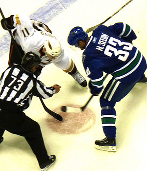 Saku Koivu - Koivu faces off with Henrik Sedin of the Vancouver Canucks in 2009.