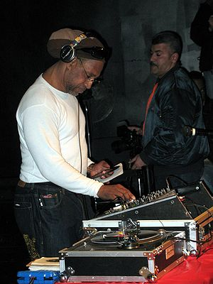 "DJ Kool Herc - Herc spins records in the Hunts Point section of the Bronx at a 28 February 2009 event addressing the ""West Indian Roots of Hip-Hop."""