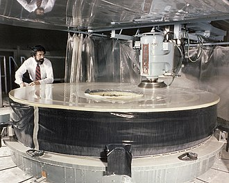 PerkinElmer - Polishing of Hubble's primary mirror begins at Perkin-Elmer corporation, Danbury, Connecticut, May 1979. The engineer pictured is Dr. Martin Yellin, an optical engineer working for Perkin-Elmer on the project.