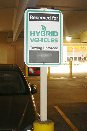 Reserver parking sign for hybrid vehicles at a...