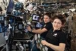ISS-61 EVA-4 (d) Jessica Meir and Christina Koch at the robotics workstation.jpg