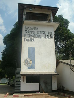 "Tower reads, ""Tanzanian Training Centre for International Health, Ifakara""."