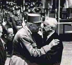 Cheek kissing - French president Charles de Gaulle kisses Argentine president Arturo Illia in 1964.