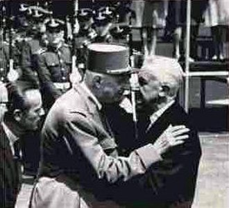 Cheek kissing - French president Charles de Gaulle kisses Argentine president Arturo Illia in 1964.