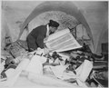 In the cellar of the Race Institute in Frankfurt, Germany, Chaplain Samuel Blinder examines one of hundreds of... - NARA - 531306.tif