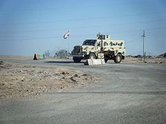 cougar vehicle i light armored vehicle at checkpoint