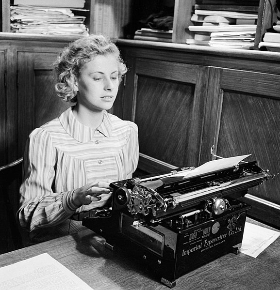 File:Iris Joyce at work on her typewriter in an office prior to joining the Women's Land Army in 1942. D8792.jpg