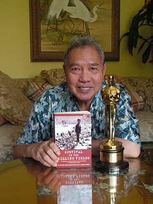 Jack Ong - Jack Ong, Executive Director of The Dr. Haing S. Ngor Foundation, displays Dr. Ngor's Best Supporting Actor Academy Award for The Killing Fields and the recently published second edition of Ngor's autobiography, Survival in the Killing Fields