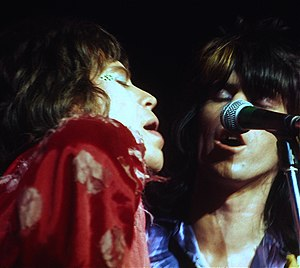 The Rolling Stones American Tour 1972 - Mick Jagger and Keith Richards share a microphone during the June 1972 Winterland shows