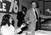 """Congressman J. J. Pickle of Texas hands King a promotional """"squeaky pickle"""" at a campaign rally in Austin, Texas, 1976."""
