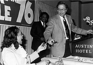 """J. J. Pickle - Jake Pickle hands Coretta Scott King a """"squeaky pickle"""" at a campaign rally in Austin, 1976"""
