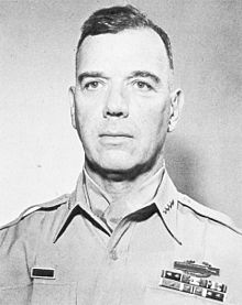 Head-and-shoulders photo of General James Van Fleet, 60 years of age, shown wearing khaki uniform blouse, four-star insignia and neckerchief.