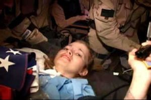 Jessica Lynch - A combat camera video shows the April 1, 2003, footage of Lynch on a stretcher during the rescue in Iraq.